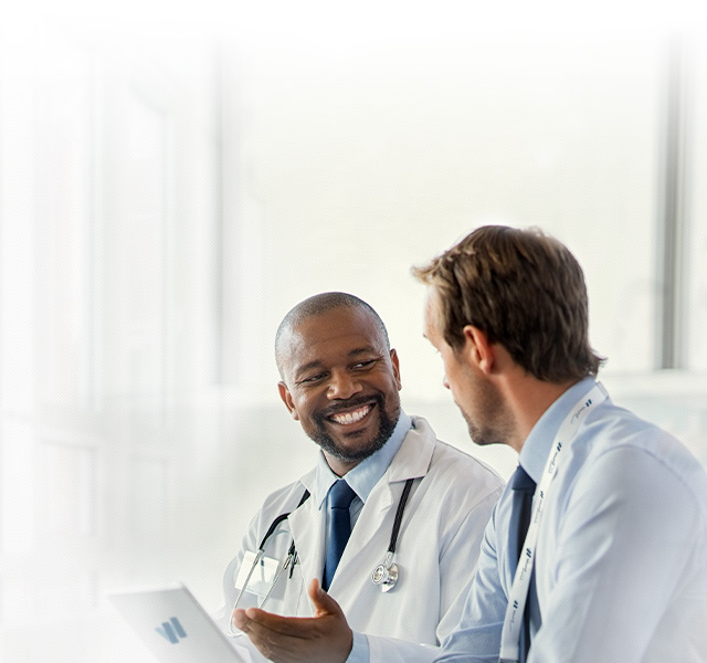 Background Image of 2 wound care doctors discussing healing